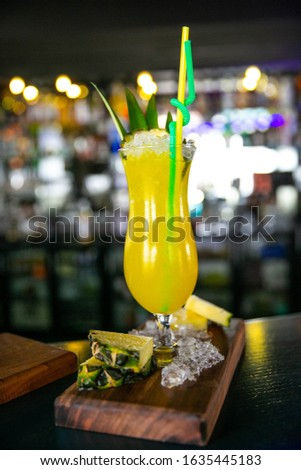 Yellow decorate with pineapple slices and restaurant background #1635445183