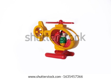 Multicolored toy helicopter on a white background. Plastic toy, children's flying machine