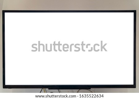 Closeup of a big smart tv with empty screen isolated on white background #1635522634