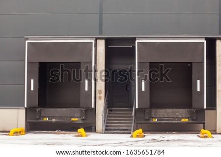 store rear entrance for cargo unloading with closed roll gates  #1635651784
