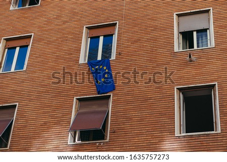 Flag of the European Union. The flag of the European Union hangs on the building. #1635757273