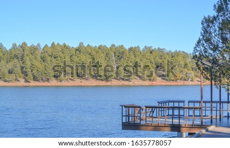 Peaceful view of a deck extended over Fool Hollow Lake in Show Low, Navajo County, Apache Sitgreaves National Forest, Arizona USA