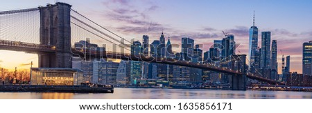 Panorama photo sunset time cityscape Manhattan.A lot of business buildings in line.Light of the city it turn on. Color sky very awesome. point view from Dumbo Brooklyn. Selective focus.