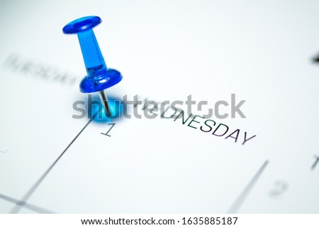 Blue push pin on the 1st  date of the calendar Wednesday - 1st of April Wednesday - April fools day 2020 Royalty-Free Stock Photo #1635885187