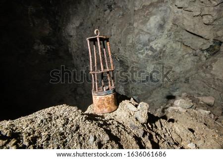 Old miners oil kerosene lamp at underground mine #1636061686