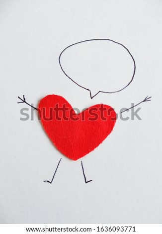 Red heart made of red cotton fabric on a white background with painted arms and legs. Symbol of love with a thought bubble for inscription, empty space for text, copy space