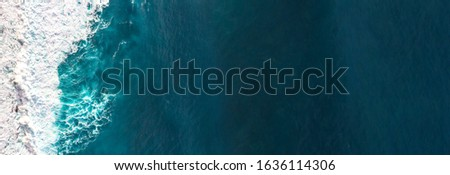 Aerial view to waves in ocean Splashing Waves. Blue clean wavy sea water. Royalty-Free Stock Photo #1636114306