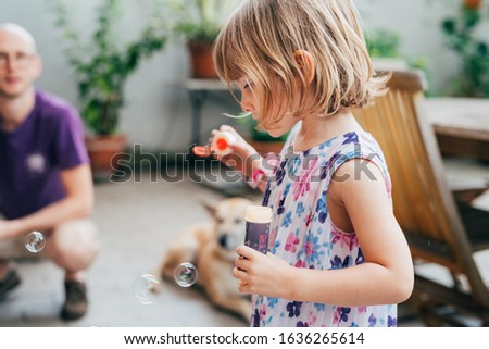 Beautiful female toddler playing with bubble soap - innocence, toys, game concept #1636265614