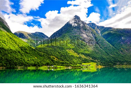 Mountain green lake landscape. Green lake in mountains. Mountain lake view. Mountain lake village #1636341364