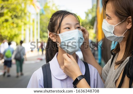 Asian child girl wearing medical mask in public area at risk of disease,people prevent infection from Corona virus in Wuhan China,Influenza virus,protection Coronavirus,MERS-CoV,2019-nCoV,Covid-19 #1636348708