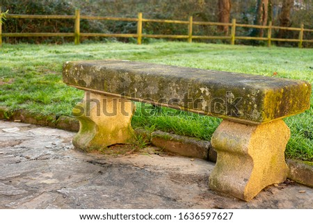 Stone bench in the park to rest and relax #1636597627