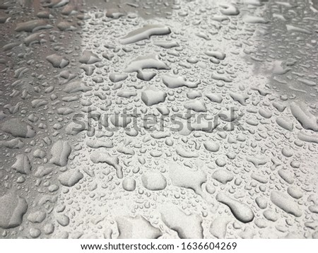Raindrops on the surface. Wet surface. Drops. #1636604269