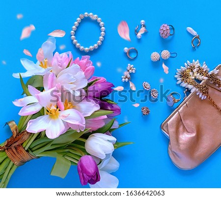 jewelry women accessories white pearl rings and earrings with tulip Bouquet pink and gold cosmetic case on blue background, costume luxury fashion accessory abstract #1636642063