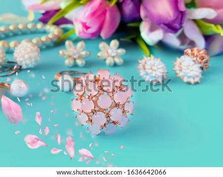 jewelry women accessories white pearl rings and earrings with tulip Bouquet pink and gold cosmetic case on blue background, costume luxury fashion accessory abstract #1636642066