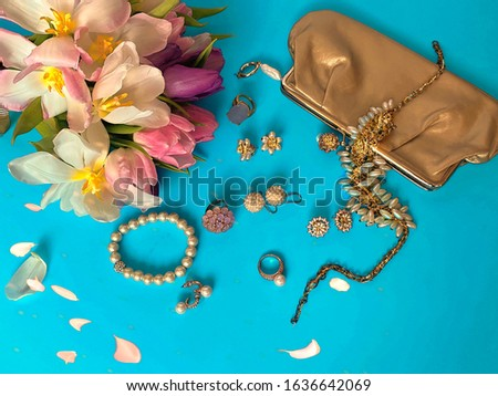 jewelry women accessories white pearl rings and earrings with tulip Bouquet pink and gold cosmetic case on blue background, costume luxury fashion accessory abstract #1636642069