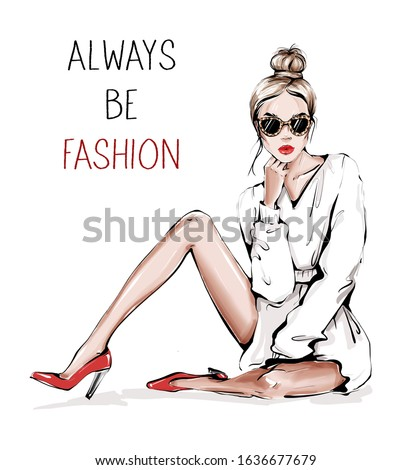 Hand drawn beautiful young woman in sunglasses with leopard print. Fashion woman. Girl with bun hairstyle. Sketch. Fashion illustration.