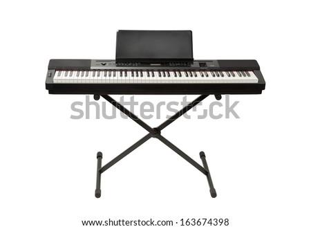 digital piano synthesizer isolated on white Royalty-Free Stock Photo #163674398