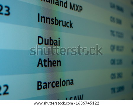 Departure board at the airport, show Innsbruck, Dubai, Athen, Barcelona time flight schedule. Departures display board at airport terminal showing international destinations flights. #1636745122