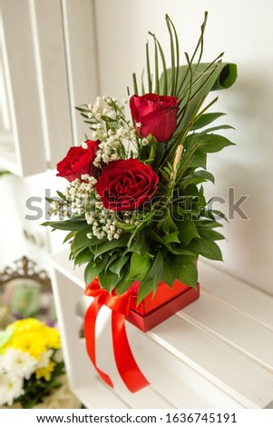 Beautiful handmade red box with floral arrangement. The floral arrangement is three red roses and green leaves. A wonderful gift for a woman. #1636745191