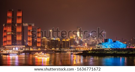 Night long exposure of Chongqing cityscape. Reflection of the skyscrapers and modern buildings in the water of Yangtze river. Landscape panoramic view of downtown in developed Chinese metropolis city. #1636771672