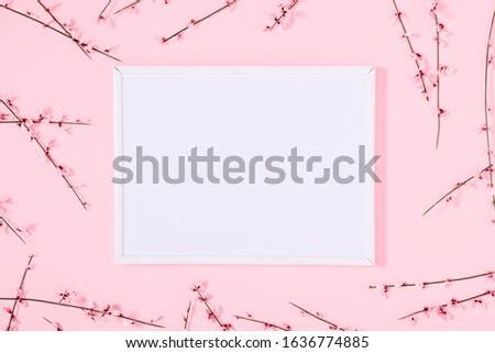 Beautiful flowers composition.  Blank frame for text, pink flowers on pastel pink background. Valentines Day, Easter, 8th march, Mother day background. Flat lay, top view, copy space