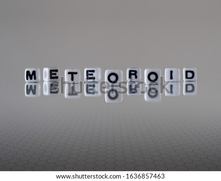 meteoroid concept represented by wooden letter tiles