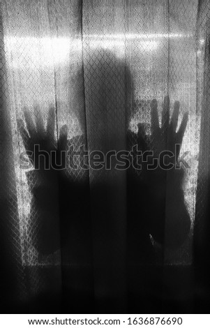horror background woman. silhouette scared woman hand behind glass window.  #1636876690
