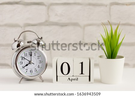 April 1 on a wooden white calendar. April 1 on a light background. Spring day. World laughter day. Royalty-Free Stock Photo #1636943509