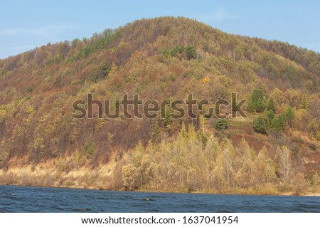 Autumn landscape, dark blue water, last warm days, river, trees, windy weather, yellow-red autumn leaves #1637041954