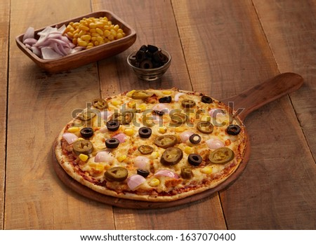 Delicious Italian Pizza on Platter with beautiful background. #1637070400