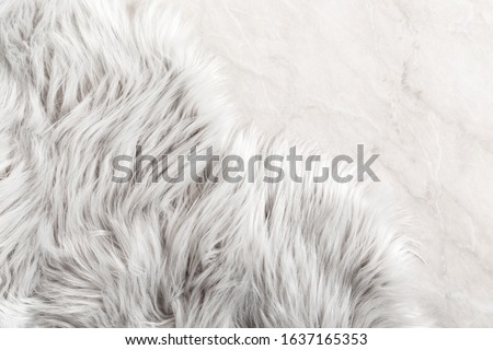 White fur for background or texture. Fuzzy white fur plaid. Shaggy blanket background. Fluffy fake textile fur. Flat lay, top view, copy space #1637165353