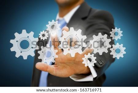 Businessman cogwheel concept #163716971