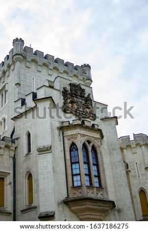 Vertical picture of a wall of Hluboka Castle (Hluboka nad Vltavou Castle), also called The State Chateau of Hluboka, a neo-gothic castle in South Bohemia, in Czech Republic