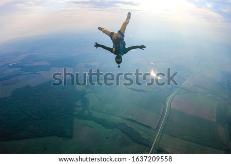 Hobbies man. Free people above earth prefere active sports. Bird men conquers sky. Flying people in professional suit above earth. Extreme as a hobby. Royalty-Free Stock Photo #1637209558