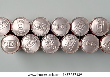 Many new aluminium cans of soda soft drink or energy drink containers. Drinks manufacturing concept and mass production #1637237839