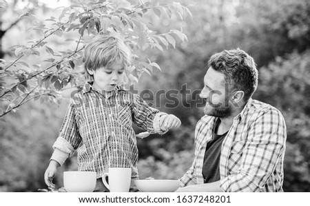 Father teach son eat natural food. Little boy and dad eat. Organic nutrition. Healthy nutrition concept. Nutrition habits. Family enjoy homemade meal. Personal example. Nutrition kids and adults. #1637248201