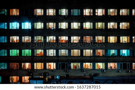 colorful lights inside windows in building at night