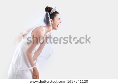 Bride laughing expressively on studio during the photo session. Copy space #1637341120