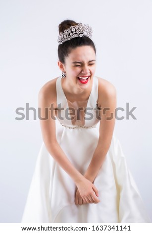 Bride laughing expressively on studio during the photo session. #1637341141