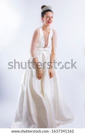 Bride laughing expressively on studio during the photo session. #1637341162