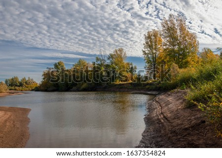 Autumn landscape river sandy shores, rifts and stretches, dark blue cold water, a sad time to catch eyes, a colorful farewell to the summer #1637354824