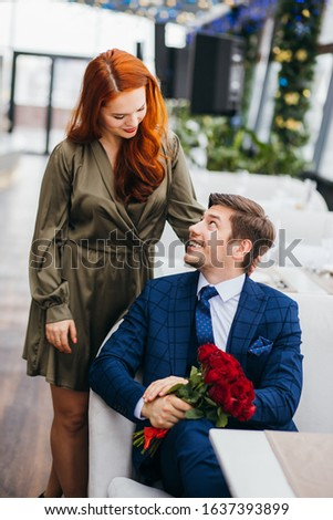 beautiful caucasian couple on a date in rich restaurant, celebrating birthday or anniversary together, two people in love. relationship, love concept #1637393899