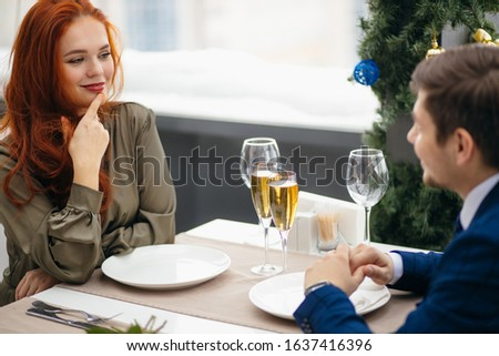 beautiful caucasian couple on a date in rich restaurant, celebrating birthday or anniversary together, two people in love. relationship, love concept #1637416396