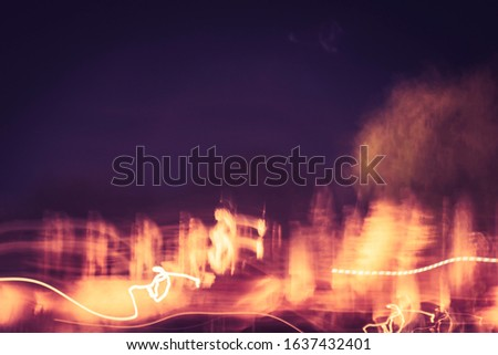 Long exposure photography of Light painting light trails at night by slow shutter technique.Speed of movement of abstract background in dark night light lines with long exposure. Bright highlights