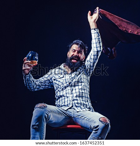 Alcohol abuse: drunk man looking at a glass of whiskey. Actual social problem. Treatment for alcohol problems. Alcohol concept #1637452351
