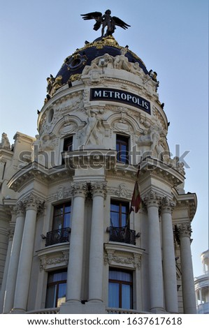 The facade of Metropolis building in the city center of Madrid, Spain. #1637617618