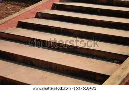 Abstract stairs in Red, abstract steps, stairs in the city, granite stairs, wide stone stairs, steps. #1637618491