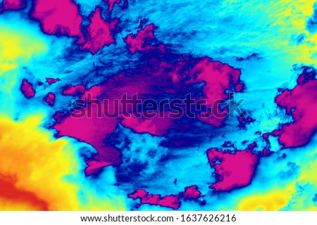 Conceptual rainbow colored background of thermal clouds weather report forecast thermal screen radar imaging Royalty-Free Stock Photo #1637626216