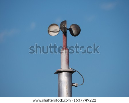 Anemometer or air speedometer on blue sky background  #1637749222