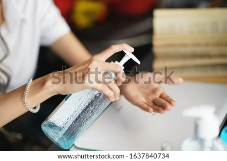 women washing hands with alcohol gel or antibacterial soap sanitizer after using a public restroom.Hygiene concept. prevent the spread of germs and bacteria and avoid infections corona virus           Royalty-Free Stock Photo #1637840734
